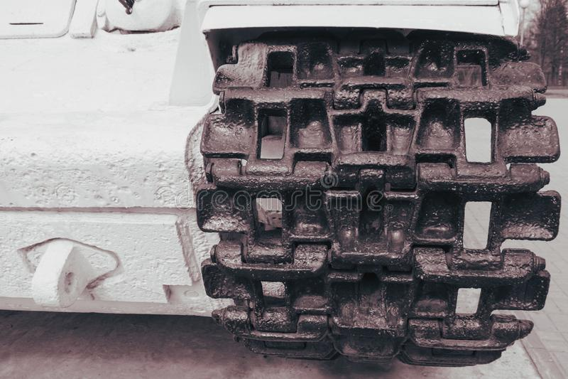 Tank Caterpillar. Of a large white tank close-up royalty free stock photo