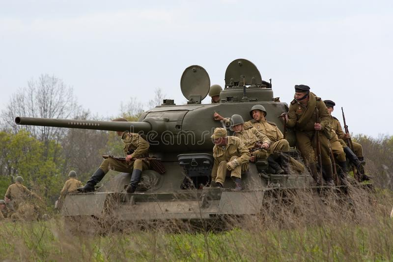 Tank with russian soldiers. stock photos