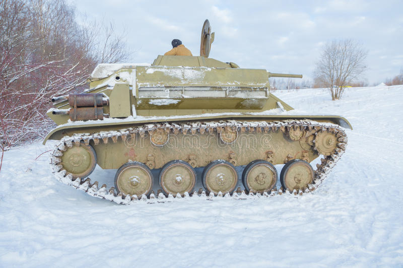 Tank t-70 with an unfolded cover of the engine compartment stock photography