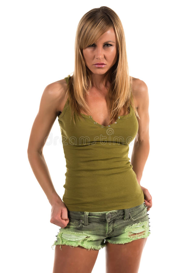 Tank top. Pretty petite blonde woman in an olive green tank top stock photo