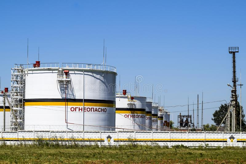 Tank the vertical steel. Capacities for storage of oil products. Caption: flammable. royalty free stock image