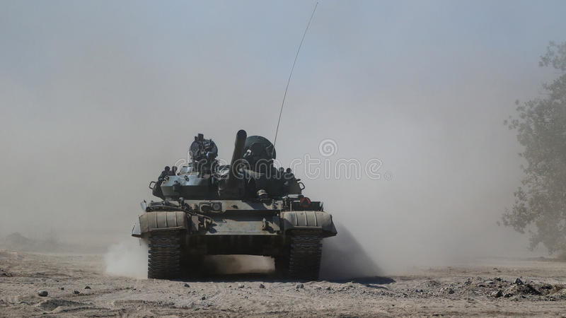 TANK WARSAW PACT. Tank T-55 off-road in the dust royalty free stock photo