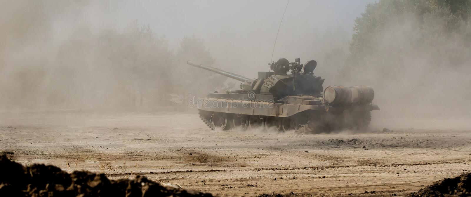 TANK WARSAW PACT. Tank T-55 off-road in the dust stock photography