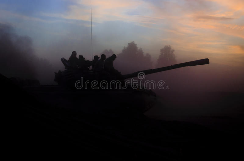 TANK WARSAW PACT. Tank T-55 off-road in the dust at sunset royalty free stock photography