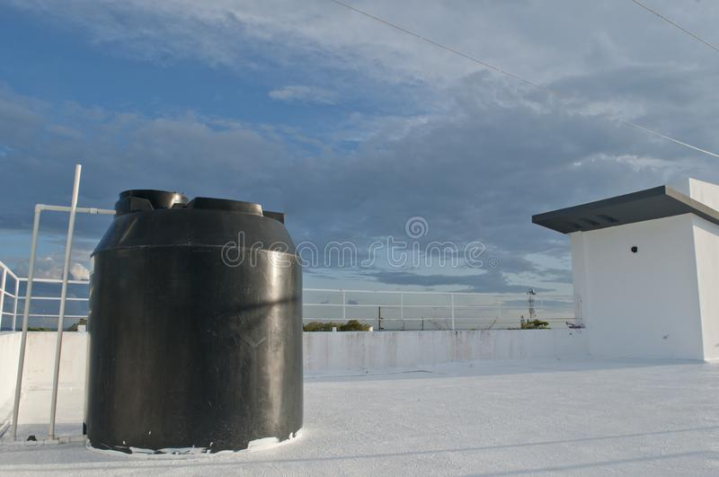 Tank for water collection on the Caribbean roof royalty free stock photo