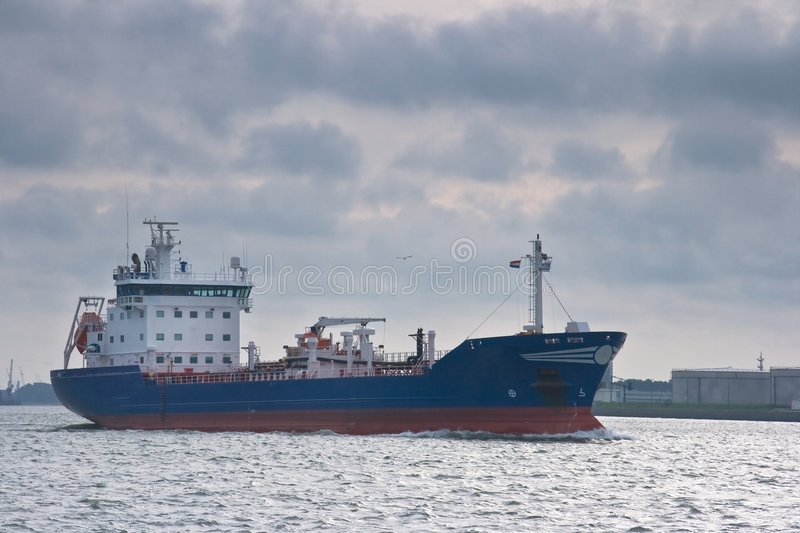 Tanker. Sailing out from the harbour to the sea royalty free stock photography