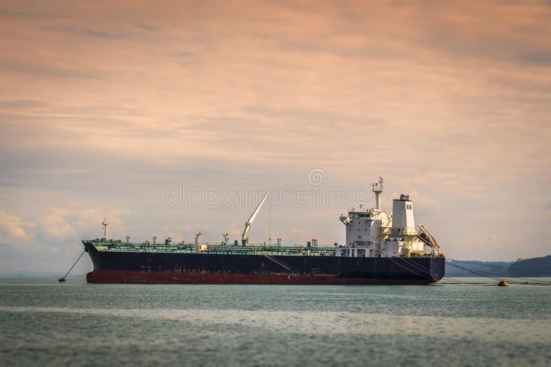 The tanker is at anchor. An empty tanker is in the bay at anchor royalty free stock photos