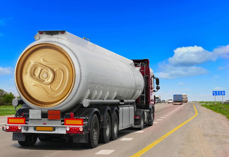 Tanker with chrome tanker on the highway. Fuel truck transports beer in a can. Conceptual idea royalty free stock images
