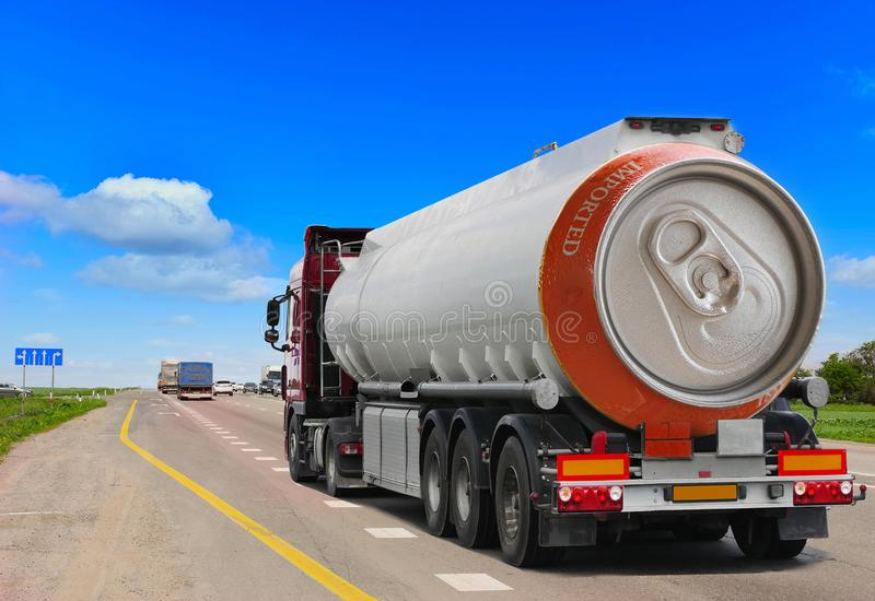 Tanker with chrome tanker on the highway. Fuel truck transports beer in a can. Conceptual idea stock photography