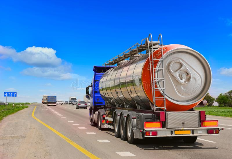 Tanker with chrome tanker on the highway. Fuel truck transports beer in a can. Conceptual idea stock image