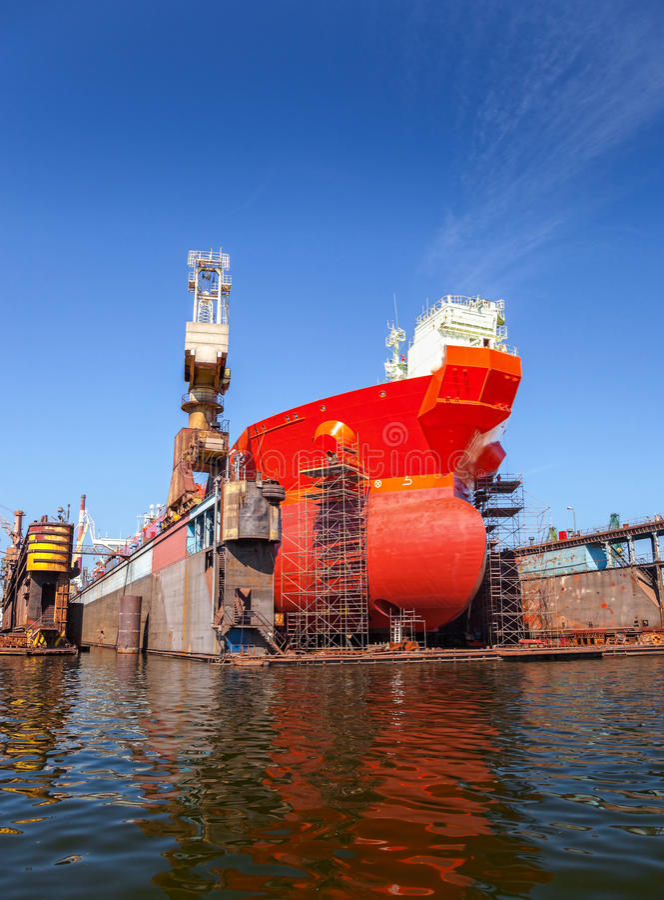 Tanker in dry dock. A large tanker repairs in dry dock. Shipyard Gdansk, Poland stock photo