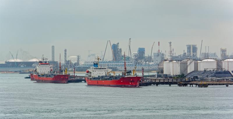 Tanker in front of an oil refinery plant stock photos