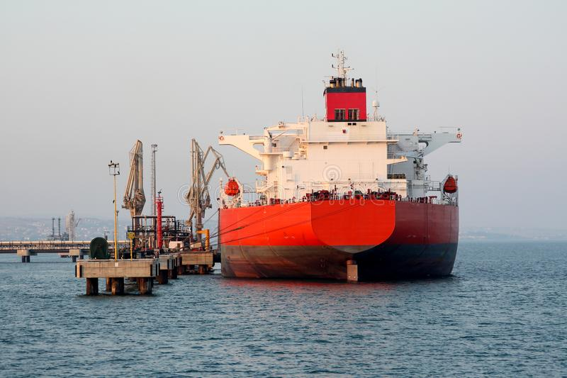Tanker at the quay of LNG terminal. stock images