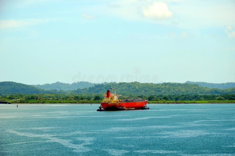 Tanker ship transiting through Panama Canal. Tanker ship anchored on the Gatun Lake during her transit through the Panama Canal on beautiful sunny day royalty free stock photography