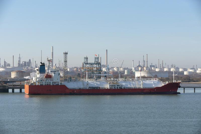 Tanker ship on berth in a refinery UK stock photo