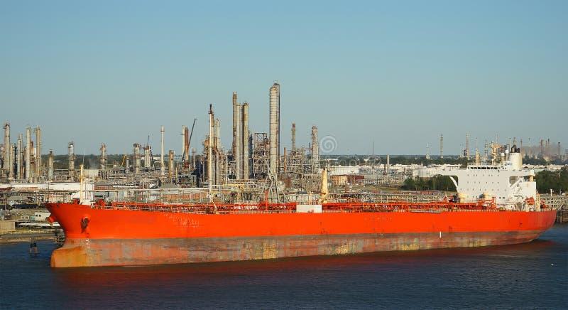 Tanker ship in front of an oil refinery. Tanker in front of an oil refinery royalty free stock photo