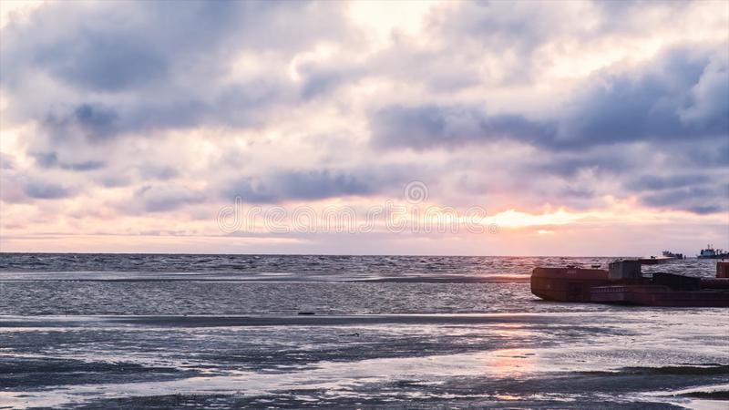 Tanker ship park in sea, Crude oil tanker and LPG tanker loading at sunset. Video. Sea view with floating tankers royalty free stock photo