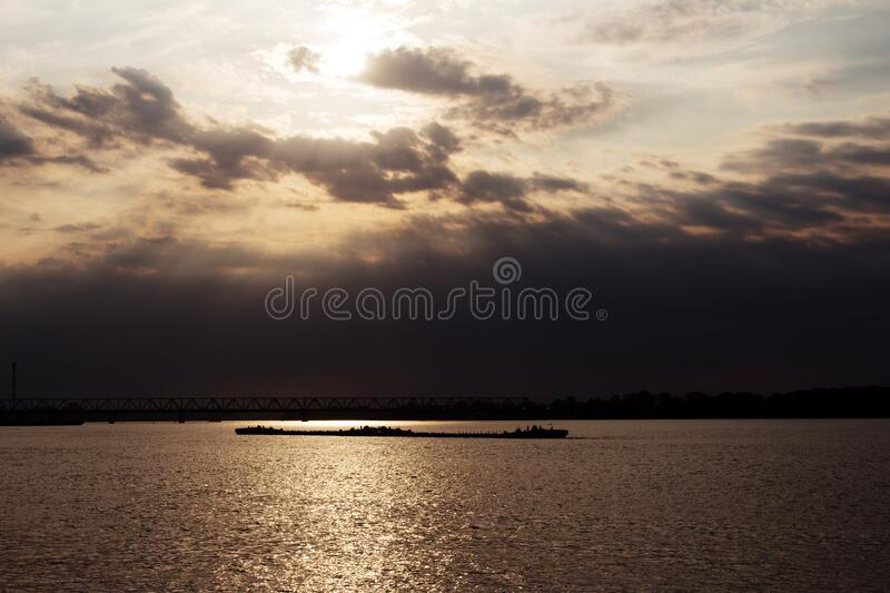 Tanker ship on the river Danube at Sunset in Belgrade, Serbia with beautiful dramatic sky and clouds royalty free stock image