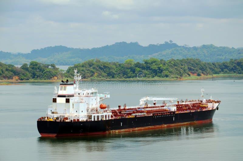 Tanker ship transiting through Panama Canal. Tanker ship sailing on the Gatun Lake during her transit through the Panama Canal on beautiful sunny day stock image
