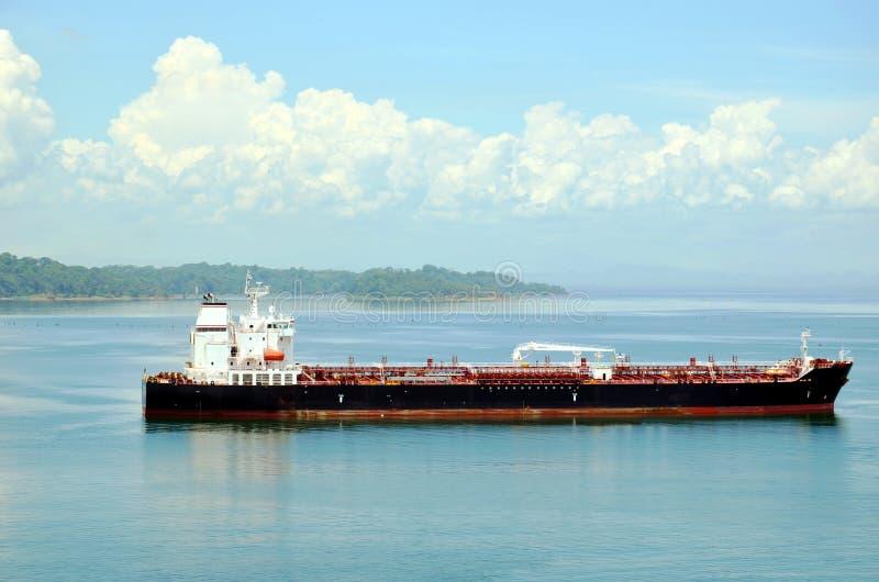 Tanker ship transiting through Panama Canal. Tanker ship sailing on the Gatun Lake during her transit through the Panama Canal on beautiful sunny day royalty free stock image