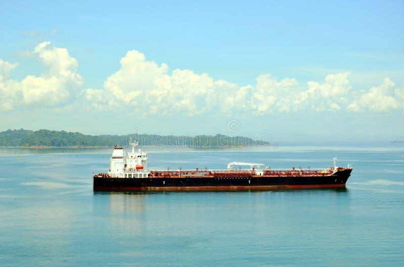 Tanker ship transiting through Panama Canal. Tanker ship sailing on the Gatun Lake during her transit through the Panama Canal on beautiful sunny day royalty free stock photos