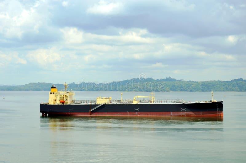 Tanker ship transiting through Panama Canal. Tanker ship sailing on the Gatun Lake during her transit through the Panama Canal on beautiful sunny day stock photos