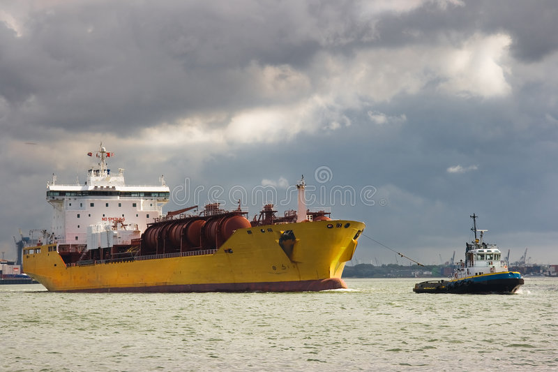 Tanker and tug. Tug and tanker are leaving the harbour stock photography