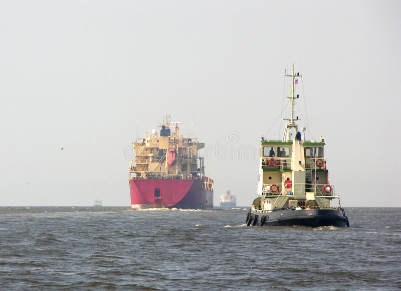Tanker and tugboat royalty free stock photography