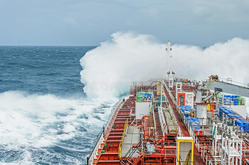 A tanker vessel against rage stock photography