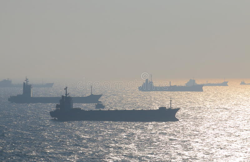 Tankers sail off the coast of Kaohsiung Taiwan royalty free stock images