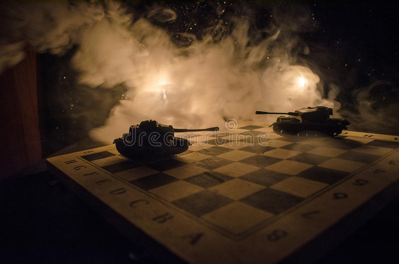 Tanks in the conflict zone. The war in the countryside. Tank silhouette at night. Battle scene. stock image