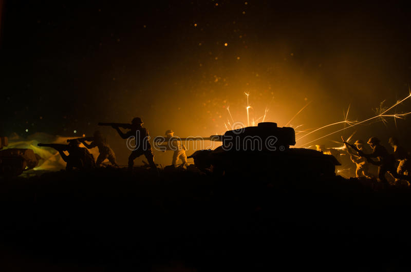 Tanks in the conflict zone. The war in the countryside. Tank silhouette at night. Battle scene. stock images