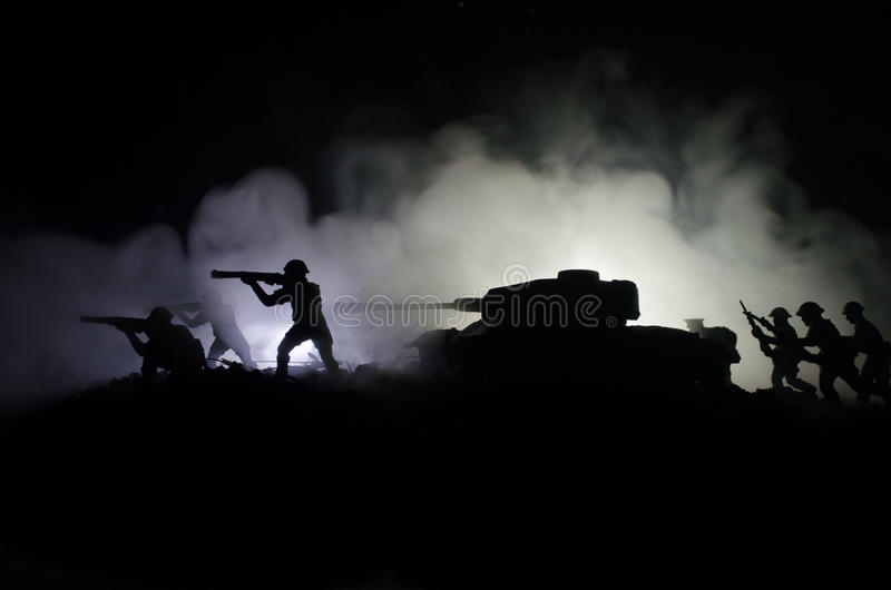 Tanks in the conflict zone. The war in the countryside. Tank silhouette at night. Battle scene. royalty free stock photos