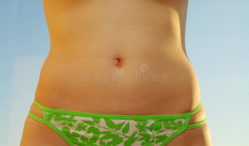 Tanned belly stock image