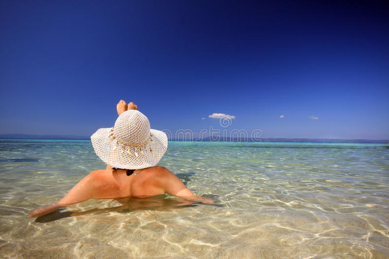 Tanned blond woman in bikini in the sea royalty free stock image