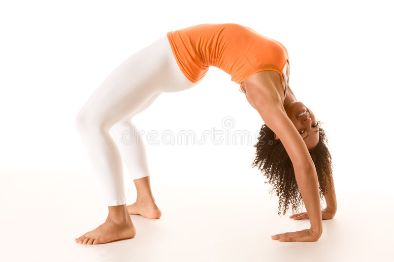 Tanned female in sport clothes performing bridge stock images