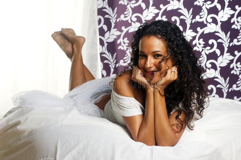 Download Tanned Girl On Bed - Head In Hands Stock Image - Image: 20884901