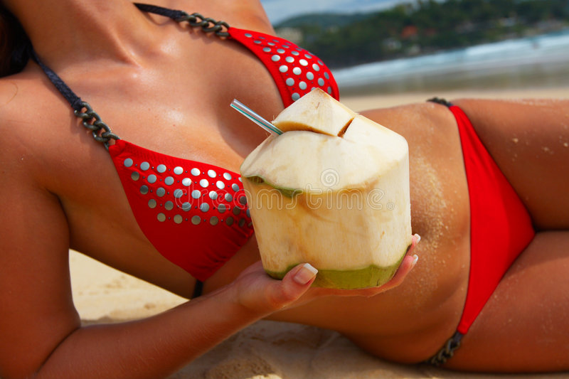 Download Tanned Girl With Coconut-coctail Stock Photo - Image: 6463508