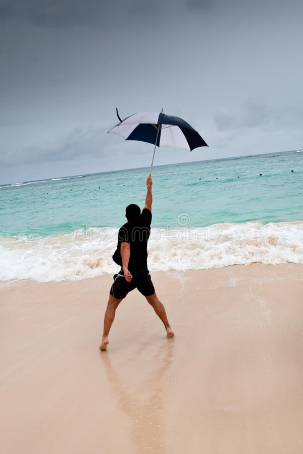 Download Tanned Man Jump With Umbrella In Blue Sea Stock Photo - Image: 21033542