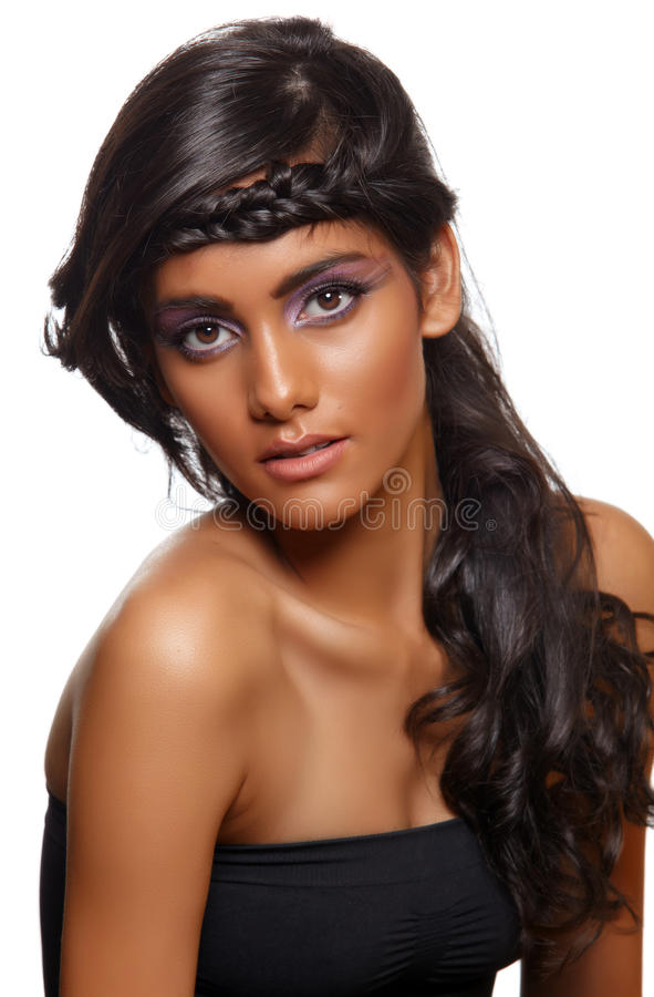 Tanned woman with curly hair stock photos