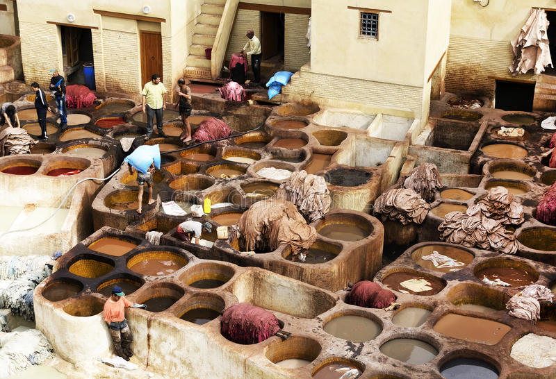 Tanneries of Fes, Morocco, Africa. Workers in the tanneries of Fes, Morocco, Africa - one of the most touristic landmarks in Fes El Bali royalty free stock photo