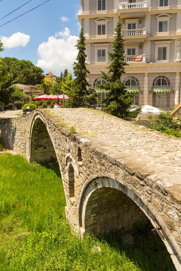 The Tanners` bridge, or Tabak bridge, a ottoman stone arch bridge in Tirana, Albania. Tirana, Albania- 01 July 2014: The Tanners` bridge, or Tabak bridge, a stock photography