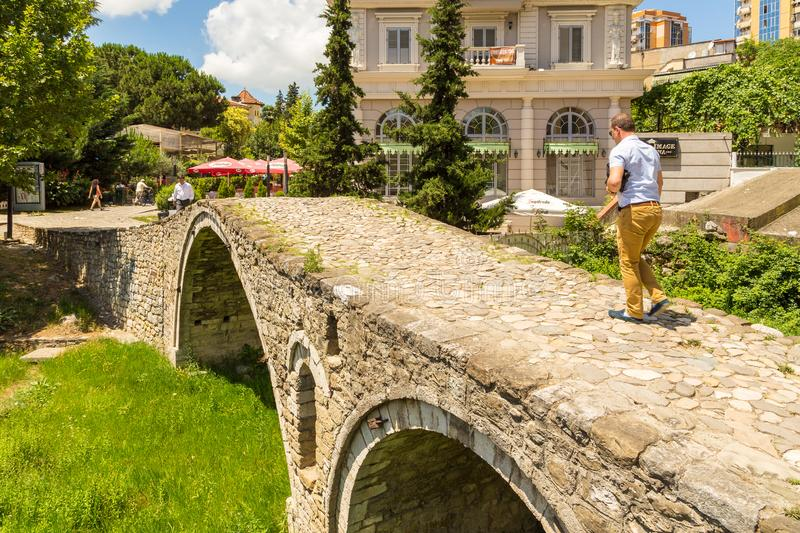 The Tanners` bridge, or Tabak bridge, a ottoman stone arch bridge in Tirana, Albania. Tirana, Albania- 01 July 2014: The Tanners` bridge, or Tabak bridge, a stock images