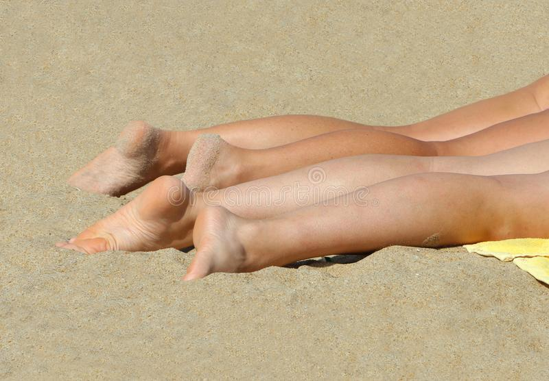 Tanning on the beach royalty free stock image