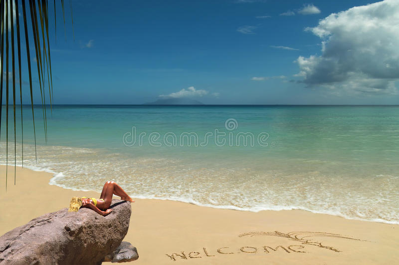 Tanning Blond Model On Welcome Beach. Stock Photo