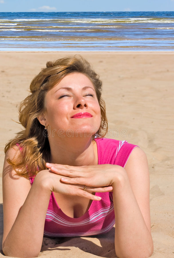 Tanning a face stock photography