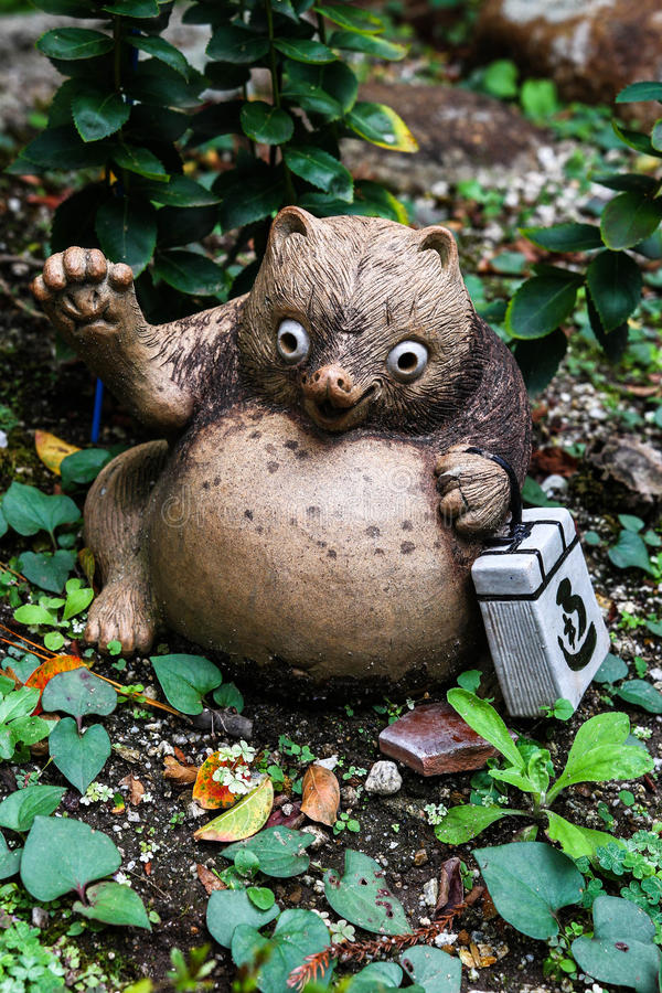 Tanuki. The Tanuki , also known as Japanese Raccoon Dog in Japanese, is a subspecies of the raccoon dog native to Japan.Researchers have suggested that they be royalty free stock image