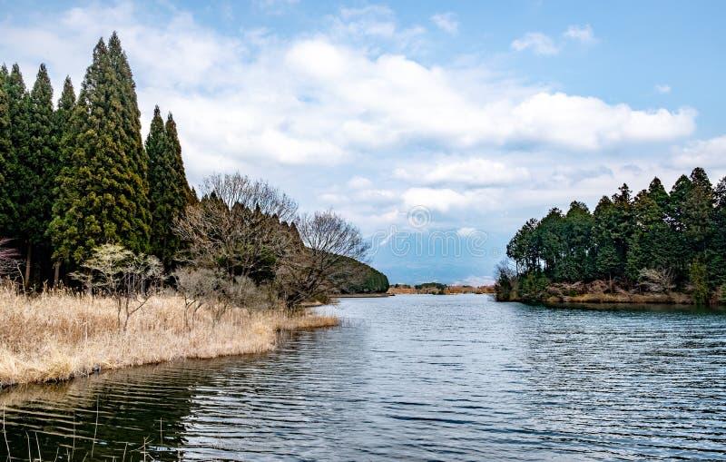 Tanuki lake , Fujinomiya , Shizuoka prefecture , Japan. Tanuki lake under cloudy sky that clouds obscure the Fuji mountain behind , Fujinomiya , Shizuoka stock photos