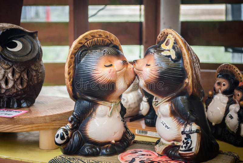 Tanuki sculpture at Kameoka Torokko. Cute royalty free stock photos