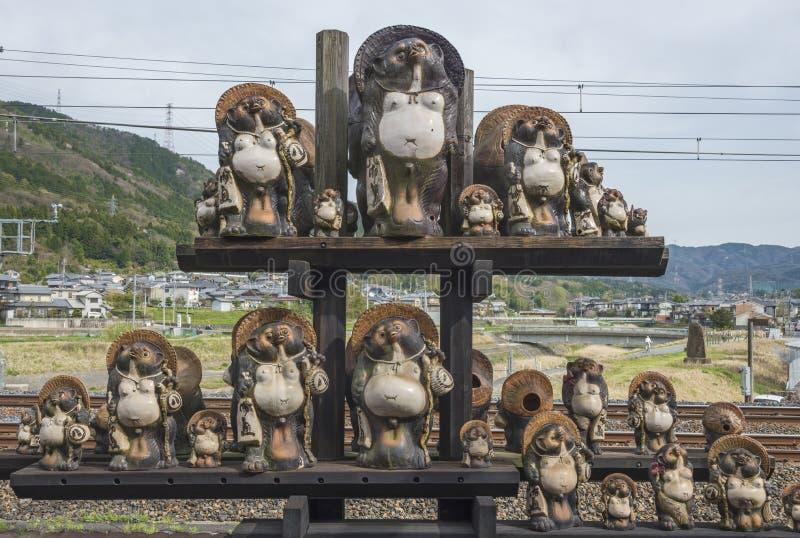 Tanuki sculpture in Kyoto, Japan. Kyoto, Japan - APRIL 06 : Tanuki sculpture at Kameoka Torokko Station in Kyoto , Japan on April 06, 2016 stock image